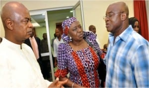 L-R:Chaplain, St. Mulumba Catholic Chaplaincy, Rev. Fr. Innocent Jooji, former Minister of State for Defence, Erelu Olusola Obada, consoling Senate President, David Mark, during the service of songs for his late sister, Mrs Mary Onmamark-Adakole, in Abuja, last Thursday