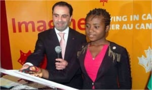 Canadian Deputy High Commissioner to Nigeria, Marcello Difanco (left) and a Student, Miss Bianca Agwunobi,cutting the tape to declare open Canadian  Education Fair in Lagos, last Friday