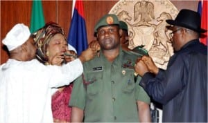 President Goodluck Jonathan (right), decorating the new Chief of Army Staff, Lt.- Gen. Kenneth   Minimah with his new rank  in Abuja last Wednesday. He was assisted by Vice President Namadi Sambo and Mrs Minimah, at the Presidential Villa in Abuja.