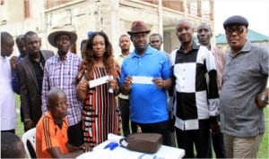 Rivers State Deputy Governor, Engr Tele Ikuru 3rd (right), his wife, Dr Mina Ikuru, displaying their membership registration cards shortly after registration in Ikuru Town, Ward 5 Andoi LGA, last Saturday. They are flanked from right to left by interim state chairman of APC, Chief Ibiamu Ikanya, Chairman APC Registration Committee for Rivers State, Engr Ebeitei Francis, Secretary of the committee, Mr Joseph Omorotionwal and Secretary, APC, Andoni LGA, Hon Kingston Sylvanus,