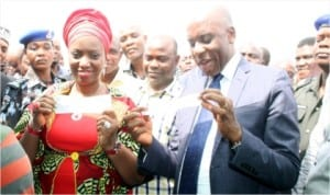 Rivers State Governor, Rt. Hon. Chibuike Rotimi Amaechi (right), and his wife, Dame Judith Amaechi, displaying their APC membership cards shortly after registration in Ubima, Rivers State, last Monday.