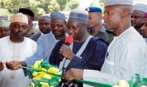 L-R: Director-General, Media and Publicity to the Governor of Kaduna State, Alhaji Ahmed Maiyaki, Commissioner for Commerce and Industry, Mr Joshua Uchissa, Governor Mukhtar Yero of Kaduna State and Chairman, Nigeria Union of Journalists, Kaduna State Council, Alhaji Yusuf Idris, during the inauguration of NUJ Shopping Complex in Kaduna last Thursday.