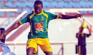 Kano Pillars striker under presure in a domestic encounter