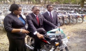 L-R: Permanent Secretary, Mrs Ibokun Odusote, Minister of Agriculture and Rural Development, Dr Akinwumi Adesina and Director, Extension Services, Mr Damil Ola Eniaiyeju, at the inauguration of 800 motorcycles to revamp agricultural extension services  across the nation in Abuja, yesterday.