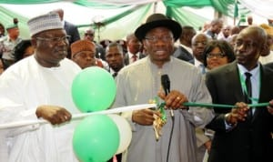 President Goodluck Jonathan (middle), cutting the tape to inaugurate the Office of the Auditor-General for the Federation in Abuja yesterday. With him are Chairman, Senate Committee on Public Accounts, Sen. Lawan Ahmed (left) and the Auditor-General for the Federation, Mr Samuel Ukura.