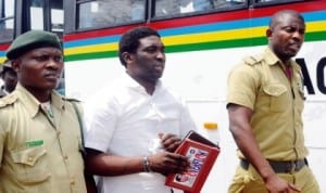 A man who stabbed his Banker wife to death in Lagos in June, 2011, Akolade Arowolo (middle), sandwitched by Prison officials after he was sentenced to death by Lagos State High Court in Ikeja, last Friday. Photo: NAN