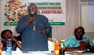nafdac Director of Planning, Research and Statistics, Dr Samson Adebayo (middle), speaking at a sensitisation workshop for medicine sellers and distributors within the bridge-head drug market at Onitsha in Anambra State on Friday. With him are the head of nafdac in Anambra, dr christiana esenwah (left) and chairman, bridge-head drug market, Mr Ugochukwu Nwosu. Photo: NAN