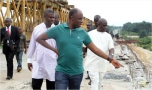 Rivers State Governor, Rt. Hon. Chibuike Amaechi (centre), member representing Opobo/Andoni Federal Constituency, House of Representatives, Hon. Dakuku Peterside (left) and Commissioner for Works, Victor Giadom during the governor's inspection of the Ogoni/Opobo/Andoni Unity Road, yesterday.