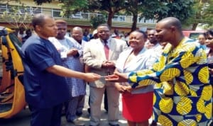 Akwa Ibom Commissioner for Health, Dr Ememabasi Bassey (left), presenting keys of a tricycle  to a focal person of the World Bank malarial control programme, Mr Monday Ikon in Uyo, recently. Photo:NAN
