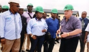 Managing Director, Metal Recycling Plant, Mr Roy Woolcock (right) explaining how the company works to members of Rivers State House of Assembly Committee on Environment headed by, Hon. Victoria Nyeche (middle), while Hon. Anderson Miller (left) and Hon, Ibiso Nwuche (3rd left) watch, during the committee's oversight function visit to the Rivers State Scrap-To-Wealth Plant at Kira in Tai LGA, recently. Photo: Chris Monyanaga.