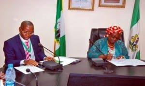 Permanent Secretary, Federal Ministry of Environment, Mr Taiye Haruna (left),  and the Minister, Mrs Lawrencia Labaran-Mallam, during the minister's assumption of duty in Abuja last Thursday. Photo: NAN