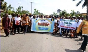 Ogonis marching during the  Ogoni Day celebration in Bori recently.