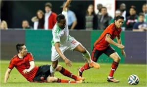Super Eagles Mikel Obi (10) against Mexican opponents during an international friendly between Nigeria and Mexico in USA last week