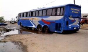 A luxury bus of the E. Ekesons Transport fleet recently broke down in a pothole in front of Rivers State Newspaper Corporation,  Port Harcourt