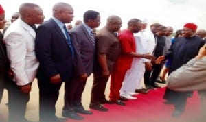 President Goodluck Jonathan in a hand shake with  some Delta State Commissioners  on his arrival at the Asaba International Airport enroute Anambra  State for the ground  breaking for the second Niger Bridge in Onitsha,  recently.