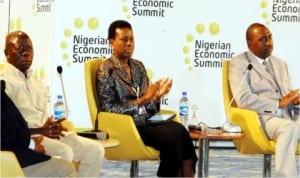 L-R: Gov. Adams Oshiomhole; Vice-Chairman, Nigerian Economic Summit Group (nesg), Mrs Sola David-Borha, and Supervisory Minister of National Planning, Amb. Bashir Yuguda, at the close of the  20th Nigerian Economic Summit in Abuja, yesterday.