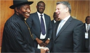 President Goodluck Jonathan (left) in a handshake with the Chief Executive Officer of Shell Petroleum International, Mr Ben van Beurden, during a meeting in Amsterdam, Netherlands, yesterday
