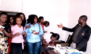 Dr Alpheaus Paul-Worika (right), Acting Group News Editor, explaining a point to students of the University of Port Harcourt, during their visit  to the Rivers State Newspaper Corporation last week. Photo: Ibioye Diama