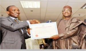 Chairman, Nigerian Electricity Regulatory Commission  (NERC), Dr Sam Amadi (left), presenting an Embedded Generation License to Governor Isa Yuguda of Bauchi State for  Yankari Power Company Limited in  Abuja, last Wednesday.