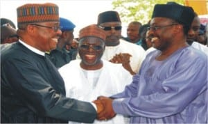 Minister of Works, Mr Mike Onolememen (left), being welcomed by the Chairman, Senate Committee on FCT, Senator Smart Adeyemi (right), at the inauguration of Rehabilitation Work on Egbe-Kabba Road, Kogi State, yesterday. With them is Kogi State Governor Idris Wada.