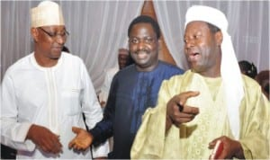 NUJ President, Malam Mohammed Garba, President, Nigerian Guild of Editors, Mr Femi Adesina and Commissioner for Information, Sokoto State, Malam  Danladi Bako, at the Nigerian Guild of Editors' Fund-Raising dinner for the building of editors' plaza in Abuja, last Thursday