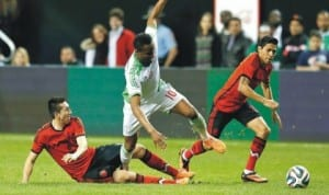 Super Eagles' Mikel Obi (10) meandering in between two Mexicans in the recent friendly game between Nigeria and Mexico in USA