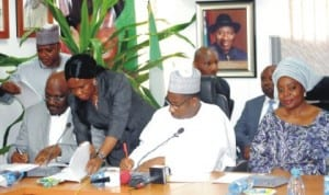 Managing Director, Centenary City Plc, Dr Odenigwe Michaels (2nd left) and FCT Minister, Senator Bala Mohammed, signing MoU on Centenary City construction in Abuja, last Friday. With them is Minister of State For FCT, Oloye Olajumoke Akinjide. Photo: NAN