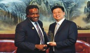 PHCCIMA President, Engr Emeka Unachukwu (left),  presenting a membership plaque to the Consular General, Liu Khan
