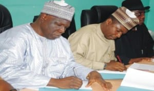National President, National Union of Road Transport Workers (NURTW), Alhaji NajeemYasin (left), and Executive Secretary, National Primary Healthcare Development Agency, Dr Ado Mohammad, signing a Memorandum of Understanding (MoU)  on a Pilot Emergency Transport Scheme in Abuja, recently.