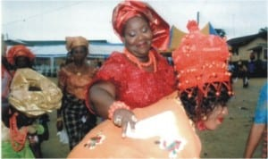 Rivers State Commissioner for Information and Communications, Mrs Ibim Semenitari appreciating the dance steps of Mrs Dorathy I Toby who performed the traditional Egerebite/Bibite womanhood ceremony at Toby Polo in Opobo Kingdom, yesterday