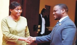Head of the United Nations Operation in Cote d' Ivoire (UNOCI), Ms Aichatou Mindaoudou (left), in a hand shake with President, Cote d' Ivoire's National Assembly,  Mr Guillaume Soro  in Abidjan last Wednesday.