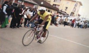 A cyclist taking the lead during a national event in  Port Harcourt, Rivers State, recently.
