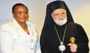 Nigeria's Permanent Representative to the UN and President, Security Council for the month of April, Prof. Joy Ogwu (left), meets His Beatitude, Gregorios 111, the Patriarch of Antioch, at the UN Headquarters, New York, yesterday.