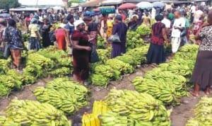 People buying bananas at Zuba fruit market in Abuja last Saturday.