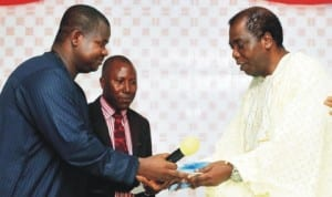Managing Director, News Agency of Nigeria, Mr Ima Niboro (left), handing over keys of an ultra-modern United Believers Mission Church building erected by him to the General Overseer, Pastor Augustus Owraigbo (right), during the hand-over and dedication of the church building in Delta State last Saturday. With them is the Chairman, Bible Truth Ministry, Pastor Vincent Omugbe. Photo: NAN