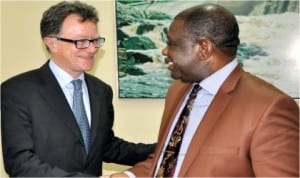 Minister of Power, Prof. Chinedu Nebo (right) welcoming the Total Senior Vice President, Supply and  Marketing, Africa and Middle-East, Mr Alain Champeau to his office in Abuja, yesterday