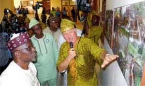 Governor Idris Wada of Kogi State (left), being shown a pictorial collage of the  Revitalized ECWA Hospital by the Revitalization Committee, Mr Don Campion, whose  missionary father, Dr George Campion, set up the hospital about 50 years ago, at the  inauguration in Egbe, Kogi State, recently.