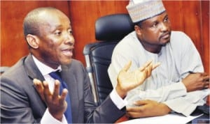 Chairman, Nigerian Electricity Regulatory Commission (NERC), Dr Sam Amadi (left), briefing newsmen on electricity fixed charge in Abuja last Wednesday. With him is Commissioner, Government and Customer Affairs, Dr Abba Ibrahim.