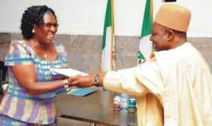 Plateau Head of Service, Mr Ezekiel Dalyop (right), presenting certificate of participation to the Commissioner for Science and Technology, Mrs Comfort Piwuna, at the close of Information Technology (it) training for commissioners and top government officials in Jos last Wednesday. Photo: NAN