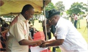 Rivers State Governor, Rt. Hon. Chibuike Amaechi, receiving an address from Chairman TUC, Comrade Chika Onuegbu,  during the May Day Celebration 2014 in Port Harcourt, yesterday.