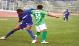 Sharks FC player trying to beat an opponent during a Premier League game in Port Harcourt, Rivers State recently