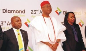 L-R: Group Managing Director, Diamond Bank, Dr Alex Otti, Chairman and Obi of Onilsha, Nnaekeka Achebe and Secretary of the bank, Nkechi Nwosu, during the 23rd Annual General Meeting of the bank in Lagos, recently.