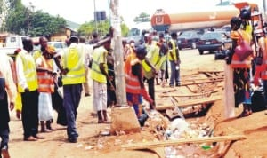 Environmental Sanitation Workers Cleaning the scene of the Nyanya explosion in Abuja last Friday. Photo: NAN