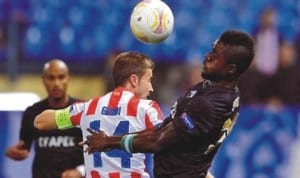 John Ogu (right) in club action. he has found playing time hard to come by at Academica.