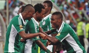 Super Eagles striker, Emmanuel Emenike (right) leads mates in celebration after scoring enroute to Brazil 2014 World Cup