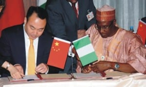 Executive Director, Nigerian Investment Promotion Council, Abubakar Hassan (right), signing MoU on Investment Promotion Cooperation with the Director -General, China Investment Promotion Agency, Mr Liu Dianxun, during a bilateral meeting between Nigeria and China at the Presidential Villa in Abuja last Wednesday Photo: NAN