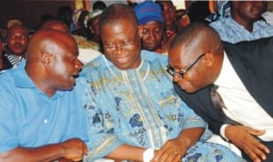 L-R: Guest Speaker, Prof. Samuel Egwu, Chairman, pdp Plateau Chapter, Dr Haruna Dabin and representative of the secretary to the  State Government, Mr Kwamkur Samuel, during a symposium on the role of labour towards 2015 election for good governance in Jos, recently. Photo: NAN.