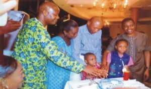 Deputy Speaker, Rivers State House of Assembly, Hon. Leyii Kwanee (right), State Chairman, Nigeria Union of Journalists (NUJ), Mr Opaka Dokubo (left), assisting a member of the Assembly's Press Corps, Mr Ruskin Amadi and his family to cut his 50th birthday cake in Port Harcourt last Monday. Photo: Chris Monyanaga