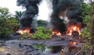 Illegal refineries being destroyed by Naval officers in Warri, recently.