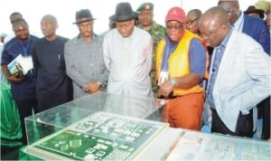 President Goodluck Jonathan (4th left) inspecting the model of NIMASA Shipyard, Dockyard and Nigeria Maritime University, Okerenkoko, at the Groundbreaking ceremony in Warri, last Saturday.With him are: Gov Emmanuel Uduaghan of Delta State (right) Gov. Willie Obialor of Anambra State (3rd l)  and other dignitries.